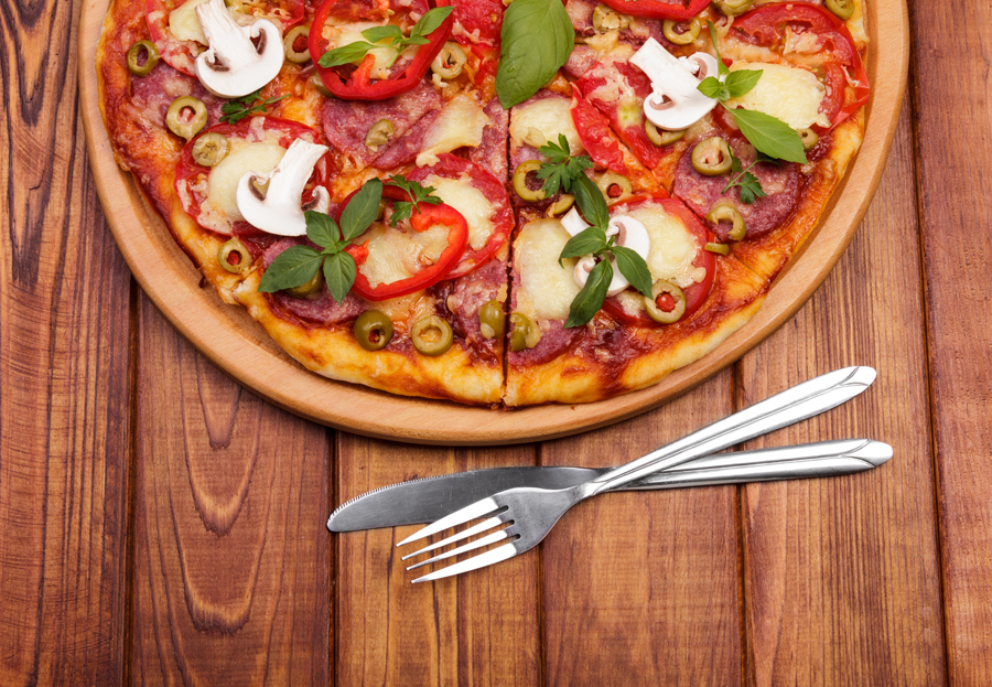 bigstock-Pizza-with-herbs-and-fork-91634918